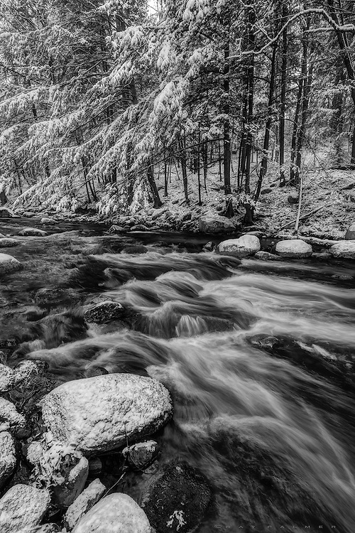 Glen Creek, Adirondacks, NY.   The new snow dusted over the old snow overnight, and I slid down the embankment in some kind of out of control clatter to get down to the stream.  The quiet returned quickly enough, an absorbing quiet that even the movement of the water did little to penetrate.  There was as much charm in the brook's movement as in the more static sweep of snow laden evergreen boughs, and the scene stood still, posing, for some time while I fumbled with cold fingers, slick rocks and precious gear.  I laughed to myself, thinking about the contrast of winter's benevolence before me, and human turmoil within me.  I lack the peace, the smoothness, even the temperament to hide what lurks below the surface of a flawed soul.   If only what is before me could give me a lesson in grace.  I am learning.