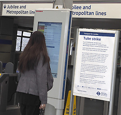 A passenger reads about the strike at the partially closed Wembley Park Station during the 48 hour  London Underground Strike, United Kingdom. Tuesday, 29th April 2014. Picture by Max Nash / i-Images