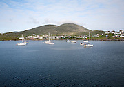 Yachts moored in the harbour at Castlebay, Barra, Outer Hebrides, Scotland, UK