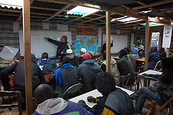 "Calais, Pas-de-Calais, France - 16.10.2016    <br />     <br /> Volunteers give language courses in a school in the camp. ""Jungle"" refugee camp on the outskirts of the French city of Calais. Many thousands of migrants and refugees are waiting in some cases for years in the port city in the hope of being able to cross the English Channel to Britain. French authorities announced that they will shortly evict the camp where currently up to up to 10,000 people live.<br /> <br /> Freiwillige geben Sprachkurse in einer Schule im Camp. ""Jungle"" Fluechtlingscamp am Rande der franzoesischen Stadt Calais. Viele tausend Migranten und Fluechtlinge harren teilweise seit Jahren in der Hafenstadt aus in der Hoffnung den Aermelkanal nach Großbritannien ueberqueren zu koennen. Die franzoesischen Behoerden kuendigten an, dass sie das Camp, indem derzeit bis zu bis zu 10.000 Menschen leben Kürze raeumen werden. <br /> <br /> Photo: Bjoern Kietzmann"