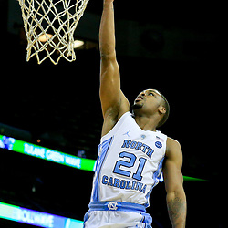 Nov 11, 2016; New Orleans, LA, USA;  North Carolina Tar Heels guard Seventh Woods (21) shoots against the Tulane Green Wave during the second half of a game at the Smoothie King Center. North Carolina defeated Tulane 95-75. Mandatory Credit: Derick E. Hingle-USA TODAY Sports