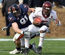 Virginia defensive end Chris Long (91) tackles Virginia Tech quarterback Tyrod Taylor (5).  The #8 ranked Virginia Tech Hokies defeated the #16 ranked Virginia Cavaliers 33-21 at Scott Stadium in Charlottesville, VA on November 24, 2007.
