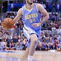 15 April 2014: Denver Nuggets guard Evan Fournier (94) dribbles during the Los Angeles Clippers 117-105 victory over the Denver Nuggets at the Staples Center, Los Angeles, California, USA.