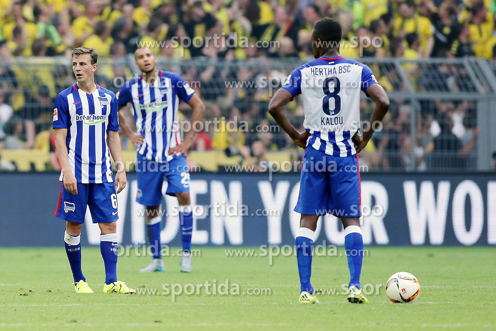 30.08.2015, Signal Iduna Park, Dortmund, GER, 1. FBL, Borussia Dortmund vs Hertha BSC, 3. Runde, im Bild v.l. Vladimir Darida (Berlin), John Anthony Brooks (Berlin) und Salomon Kalou (Berlin) stehen nach dem Tor zum 3:1 durch Adrian Ramos (Dortmund) enttaeuscht auf dem Platz // during the German Bundesliga 3rd round match between Borussia Dortmund and Hertha BSC at the Signal Iduna Park in Dortmund, Germany on 2015/08/30. EXPA Pictures &copy; 2015, PhotoCredit: EXPA/ Eibner-Pressefoto/ Hommes<br /> <br /> *****ATTENTION - OUT of GER*****