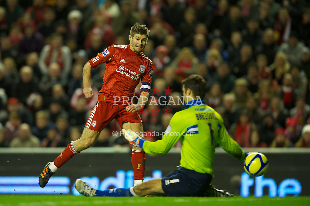 LIVERPOOL, ENGLAND - Saturday, February 19, 2012: Liverpool's captain Steven Gerrard round Brighton & Hove Albion's goalkeeper Peter Brezovan to score the fourth goal during the FA Cup 5th Round match at Anfield. (Pic by David Rawcliffe/Propaganda)