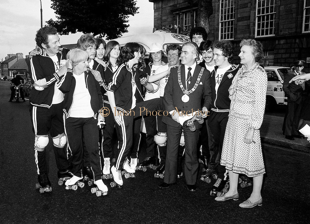 Members of the Roller All Star Hockey Club assemble outside Kilmainham Jail, Dublin, before setting out on a non-stop roller skating marathon from Dublin to Cork to raise money for the Central Remedial Clinic. Dublin's Lord Mayor, Fergus O'Brien, inspects their equipment before they leave. On the right is Senator Lady Valerie Goulding, Chairperson and Managing Director of the CRC.<br /> 15 August 1980