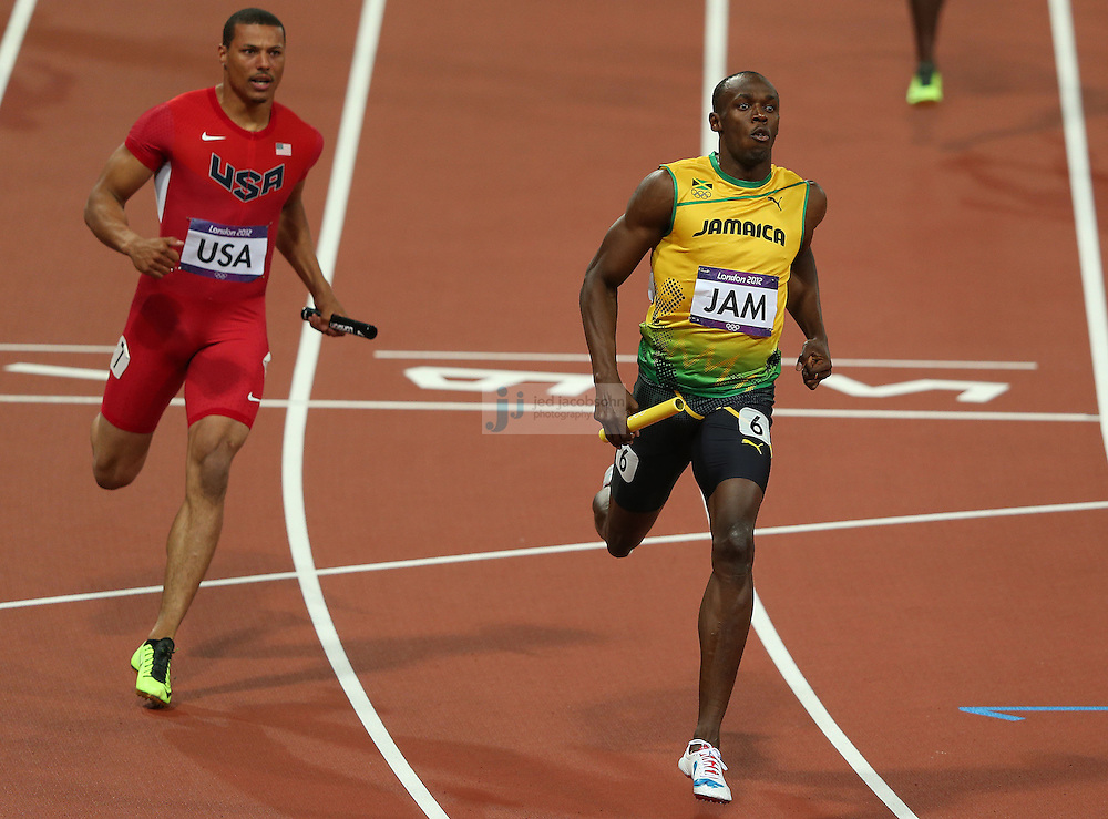 Usain Bolt of Jamaica crosses the finish line as Ryan Bailey of the USA looks on during the men's 4x100 relay race at the Olympic stadium during day 15 of the London Olympic Games in London, England, United Kingdom on August 11, 2012..(Jed Jacobsohn/for The New York Times)..
