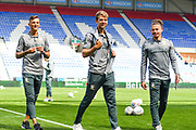 Leeds United defender Ben White (5), Leeds United forward Patrick Bamford (9) and Leeds United midfielder Kalvin Phillips (23) arrive at the ground during the EFL Sky Bet Championship match between Wigan Athletic and Leeds United at the DW Stadium, Wigan, England on 17 August 2019.