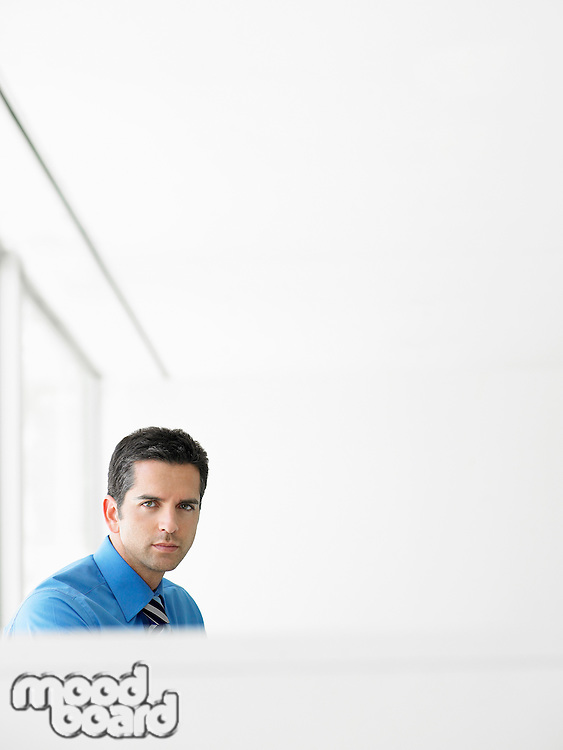 Portrait of handsome young businessman in office