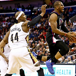Mar 20, 2016; New Orleans, LA, USA; Los Angeles Clippers guard Chris Paul (3) drives past New Orleans Pelicans forward Dante Cunningham (44) during the second quarter of a game at the Smoothie King Center. Mandatory Credit: Derick E. Hingle-USA TODAY Sports