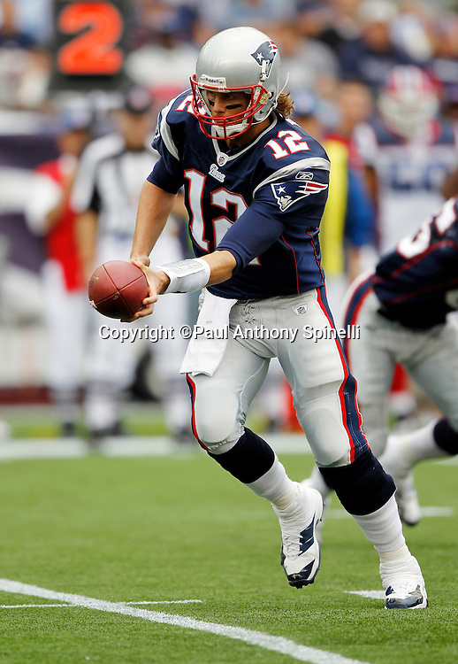 New England Patriots quarterback Tom Brady (12) hands off the ball on a running play during the NFL regular season week 3 football game against the Buffalo Bills on September 26, 2010 in Foxborough, Massachusetts. The Patriots won the game 38-30. (©Paul Anthony Spinelli)