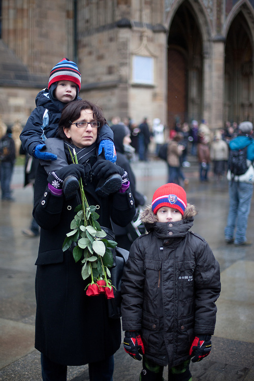 About 10000 Czech citizens accompanied the remains of Vaclav Havel from the Old Town part in Prague across Charles Bridge   up to Prague Castle, the seat of Czech presidents. Family  watching a big screen projection of the mourning ceremony for former President Vaclav Havel at Prague Castle.