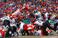 Kansas City Chiefs running back Larry Johnson (27) dives up and over the Jacksonville defense for his 18th touthdown on the season in the second quarter at Arrowhead Stadium in Kansas City, Missouri, December 31, 2006.  The Chiefs lead the Jaguars 21-10 at halftime.<br />