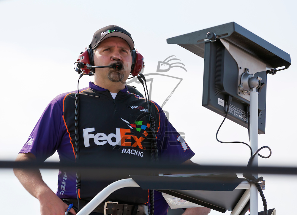 CONCORD, NC - MAY 26, 2012:  Crew Chief, Darian Grubb, watches a practice session for the Coca-Cola 600 at the Charlotte Motor Speedway in Concord, NC.