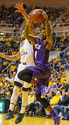 Feb 13, 2016; Morgantown, WV, USA; TCU Horned Frogs guard Chauncey Collins (1) drives baseline and shoots over West Virginia Mountaineers guard Jaysean Paige (5) during the first half at the WVU Coliseum. Mandatory Credit: Ben Queen-USA TODAY Sports