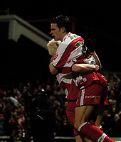 Photo: Jed Wee.<br /> Doncaster Rovers v Arsenal. Carling Cup. 21/12/2005.<br /> <br /> Doncaster's Michael McIndoe (R) leaps into the arms of Sean Thornton after scoring an early goal.