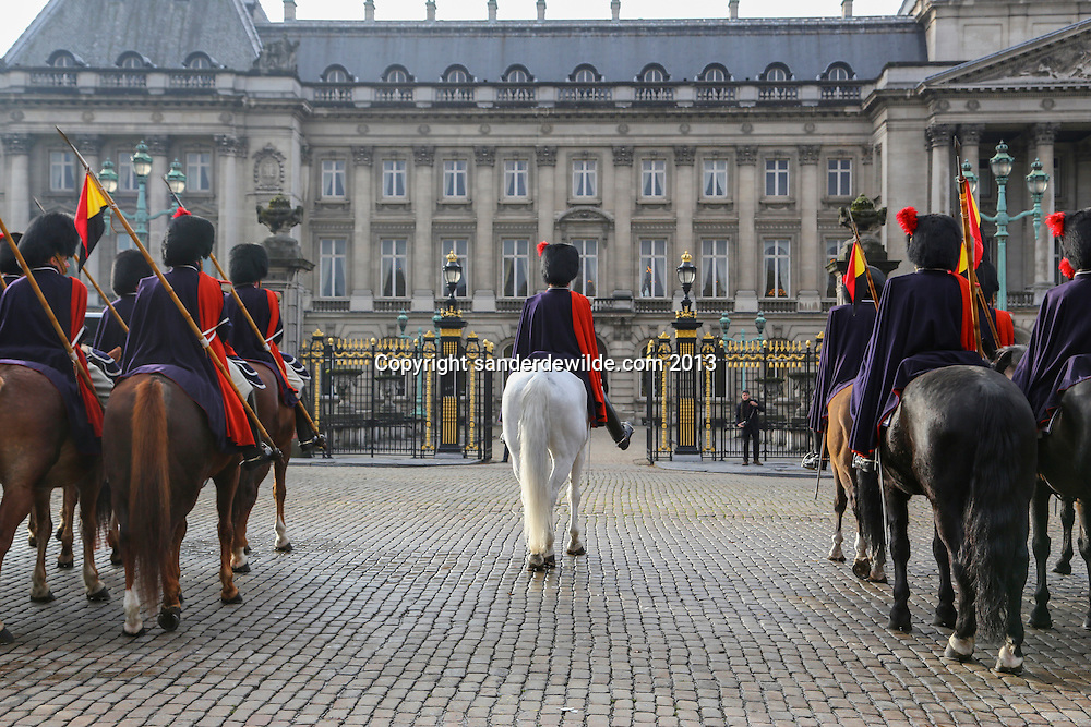 In front of the Royal Palace in Brussels a military parade is going on to honour the ambassadors visiting the King today. Chief on a white horse in the middle of the resting troups.