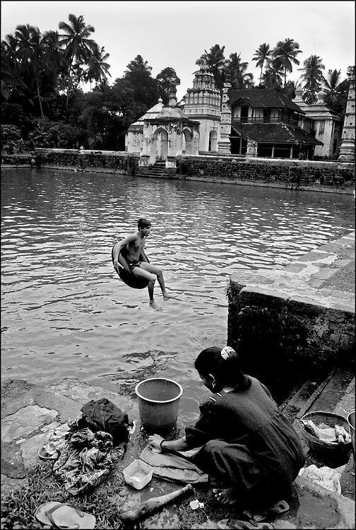Boy Swimming at a Temple Complex