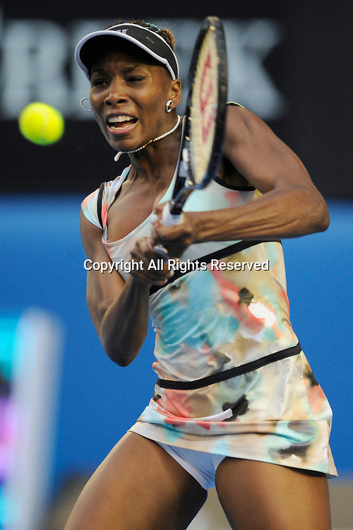 18.01.2013 Melbourne, Australia. Venus Williams of USA returns a shot in her match on day five of the Australian Open from Melbourne Park.