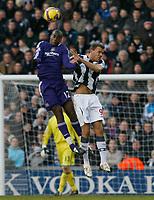 Photo: Steve Bond/Richard Lane Photography. West Bromwich Albion v Newcastle United. Barclays Premiership. 07/02/2009. Sebastien Bassong (L) gets the better of Roman Bednar (R)