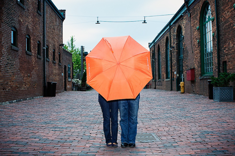 The Orange Umbrella. Captured at the Distillery District during Daphina and Charles' Engagement Lifestyle Photography Session.
