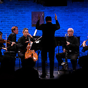 """February 9, 2015 - New York, NY : From left, violinist Shanshan Yao, pianist Eric Huebner, cellist Patrick Jee, conductor Case Scaglione, clarinetist Lino Gomez, and flutist Helen Campo perform Yotam Haber's 'Estro Poetico–Armonico II' as part of The New York Philharmonic and the 92nd Street Y's presentation of """"Contact! New Music from Israel"""" at SubCulture in Manhattan on Monday night.   CREDIT: Karsten Moran for The New York Times"""