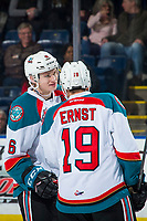 KELOWNA, CANADA - JANUARY 30: Kaedan Korczak #6 speaks to Ethan Ernst #19 of the Kelowna Rockets on the ice against the Seattle Thunderbirds  on January 30, 2019 at Prospera Place in Kelowna, British Columbia, Canada.  (Photo by Marissa Baecker/Shoot the Breeze)