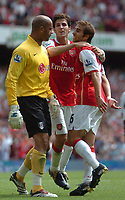 Photo: Tony Oudot. <br /> Arsenal v Fulham. Barclays Premiership. 12/08/2007. <br /> Arsenals Cesc Fabregas and Mathieu Flamini taunt Fulham keeper Tony Warner after the winning goal