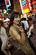 TOKYO TRANSGENDER.Transexuals who work as hostesses, advertise the clubs and bars were they work in Shinjuku's Kabukicho and try to find customers for them on the way to work. To work as a hostess is one of the usual jobs for transsexuals in Tokyo..©: Androniki Christodoulou.