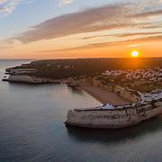Sunset aerial view on Praia da Senhora da Rocha in the south coast of Algarve tourist destination region, Portugal.