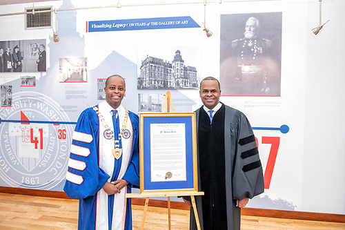 Kasim Reed and President Wayne A.I. Frederick with a Commencement citation.