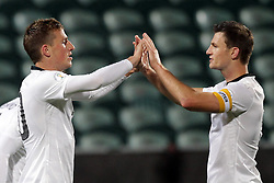 New Zealand's Chris Wood, left, celebrates his goal with  Tommy Smith in a FIFA World Cup Qualifier Match, North Harbour Stadium, Auckland, New Zealand, Tuesday, September 11, 2012.  Credit:SNPA / David Rowland