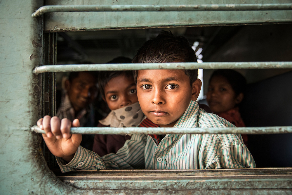 Boy by the train window. Varanasi, India