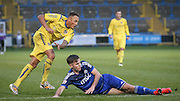 Adam Smith (Guiseley) has a shot on goal, Scott McManus (Halifax) tries to block during the Conference Premier League match between FC Halifax Town and Guiseley at the Shay, Halifax, United Kingdom on 5 December 2015. Photo by Mark P Doherty.