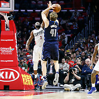 23 December 2016: Dallas Mavericks forward Dirk Nowitzki (41) takes a jump shot over LA Clippers guard Raymond Felton (2) during the Dallas Mavericks 90-88 victory over the LA Clippers, at the Staples Center, Los Angeles, California, USA.