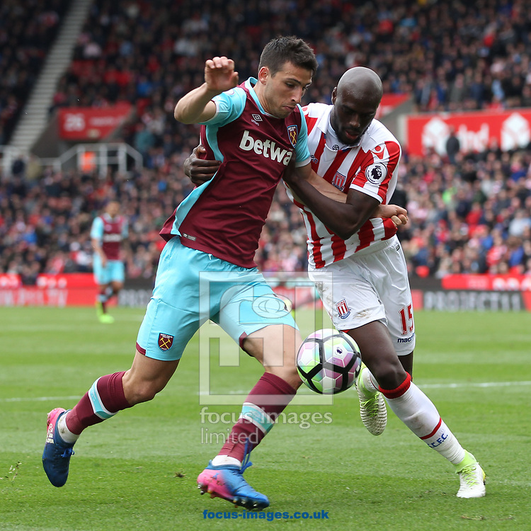 Jonathan Calleri of West Ham United and Bruno Martins Indi of Stoke City in action during the Premier League match at the Bet 365 Stadium, Stoke-on-Trent.<br /> Picture by Michael Sedgwick/Focus Images Ltd +44 7900 363072<br /> 29/04/2017