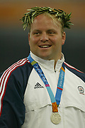 Adam Nelson of the United States smiles as he receives the silver medal in the shot put in the 2004 Olympics in Athens, Greece on Wednesday, August 18, 2004. Nelson finished second with a throw of 69-5 1/4 (21.16m)