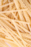 Raw pasta on white background