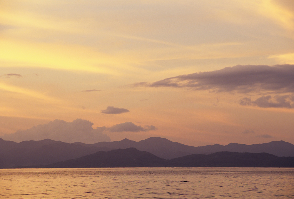 Fiji Islands, Taveuni, Waiyevo sunset w/Vanua Levu in distance