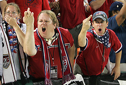 08 July 2009: Two U.S. fans make an obscene jesture at a security guard after the game. The United States Men's National Team defeated the Honduras Men's National Team 2-0 at RFK Stadium in a 2009 CONCACAF Gold Cup first round game.