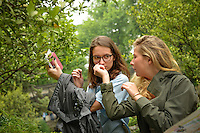 CALS students check out the smell of a citrus plant in the Humble Administrator's Garden in Suzhou.