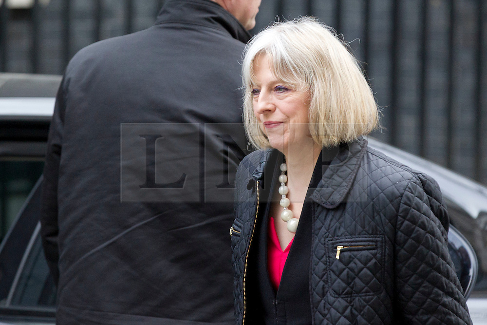 © Licensed to London News Pictures. 18/03/2014. London, UK. The Home Secretary, Theresa May, arrives for a meeting of the British cabinet on Downing Street in London today (18/03/2014). Photo credit: Matt Cetti-Roberts/LNP