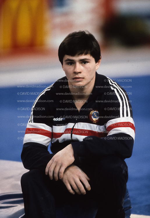 PHOENIX - APRIL 24:  Dimitri Belozerchev of the USSR waits between events during a USA - USSR gymnastics meet on April 24, 1988  at the Arizona Veterans Memorial Coliseum in Phoenix, Arizona.  (Photo by David Madison/Getty Images)