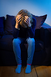 Embargoed to 0001 Thursday October 13 PICTURE POSED BY MODEL File photo dated 09/03/15 of a woman with her head in her hands as the number of alleged rapes recorded by police has more than doubled in less than four years, figures show.