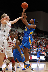January 20, 2011; Stanford, CA, USA;  UCLA Bruins guard/forward Atonye Nyingifa (11) shoots over Stanford Cardinal forward Mikaela Ruef (3) during the first half at Maples Pavilion.