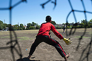 Yogesh Acharya (13) plays goalie with friends at a park across from their home in the Ivy Apartments where Thomas E. Duncan, the first confirmed Ebola virus patient in the United States, was staying with family in Dallas, Texas on October 4, 2014. Duncan is now being treated at Texas Health Presbyterian Hospital Dallas while members of his family have been isolated in the apartment. (Cooper Neill for The New York Times)