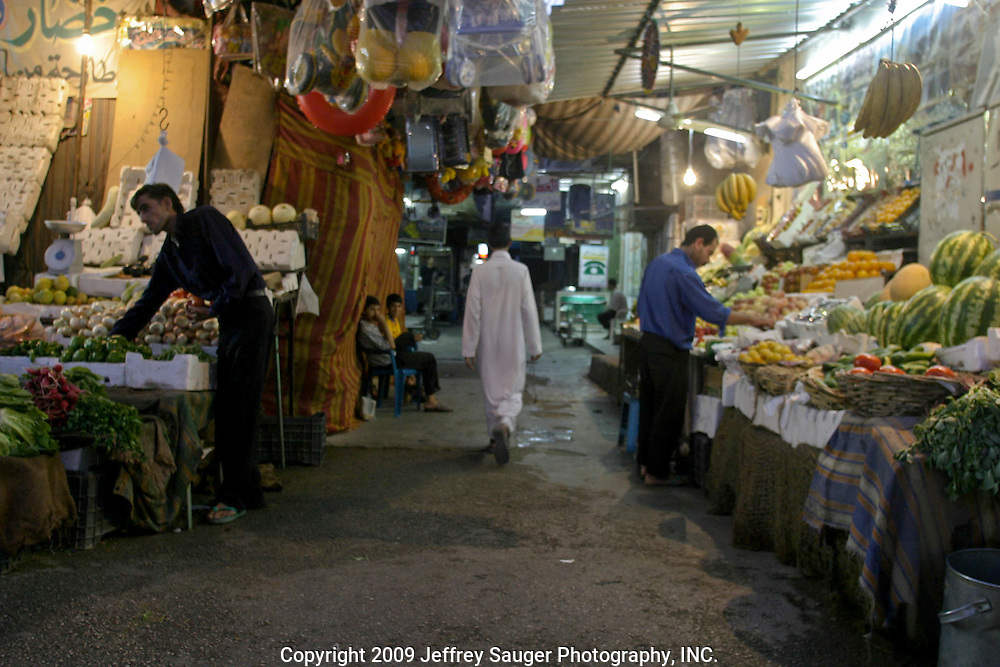 Shopkeepers ready their markets in the Iraqi area of Damascus, Syria, Saturday, July 12, 2003.