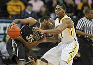 February 27 2013: Purdue Boilermakers guard Rapheal Davis (35) tries to keep the ball away from Iowa Hawkeyes forward Melsahn Basabe (1) during the first half of the NCAA basketball game between the Purdue Boilermakers and the Iowa Hawkeyes at Carver-Hawkeye Arena in Iowa City, Iowa on Wednesday, February 27 2013.