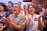 24 AUGUST 2010 -- TUCSON, AZ: Paul Mondello and his wife, Lee Mondello (CQ) from Oro Valley cheer for Gov Brewer in Tucson Tuesday night.  Gov Brewer made an appearance at Mr. An's Teppan Steak & Sushi in Tucson Tuesday night just as early returns in Arizona's primary elections were starting to come in. Brewer's victory has been credited to her signing SB 1070 and taking a tough stand on illegal immigration and against the Obama administration.   PHOTO BY JACK KURTZ