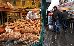 Cologne, Germany, Jan. 2012 -  Given the stylish looks of most city residents, you can imagine how much of their time and energy is spent shopping. To fuel up in the heart of the Ehrenstrasse, a popular street that has recently overflowed with new clothing stores, locals grab snacks from the Zimmermann bakery, founded in 1875, where a sublime, sugary, frosted Schnecke (or snail, meaning a raisin Danish) will keep you going at least as far as the next boutique (Ehrenstrasse 75; 49-221-25-56-32; baeckereizimmermann.de). (Photo © Jock Fistick).